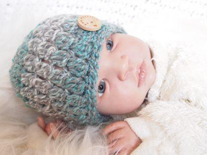 Baby beanie muts met knoop